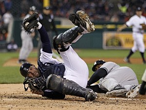 Avila tags out Andruw Jones at home