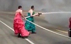 Firemen in drag put out truck fire