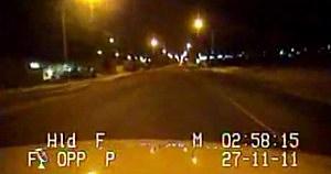 Drunk man sings Bohemian Rhapsody from back of police car