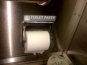 Should the toilet paper hang over or under?