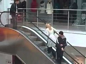 Who will win, the blonde or the escalator?