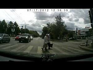 Good Samaritan helps elderly woman cross the street