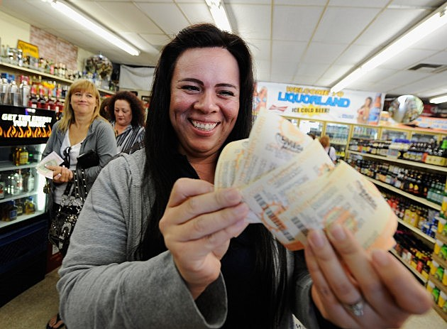 woman with lottery tickets