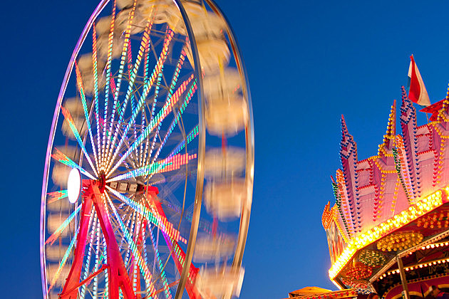 Carnival Ferris Wheel Lights Blur With Motion At Night
