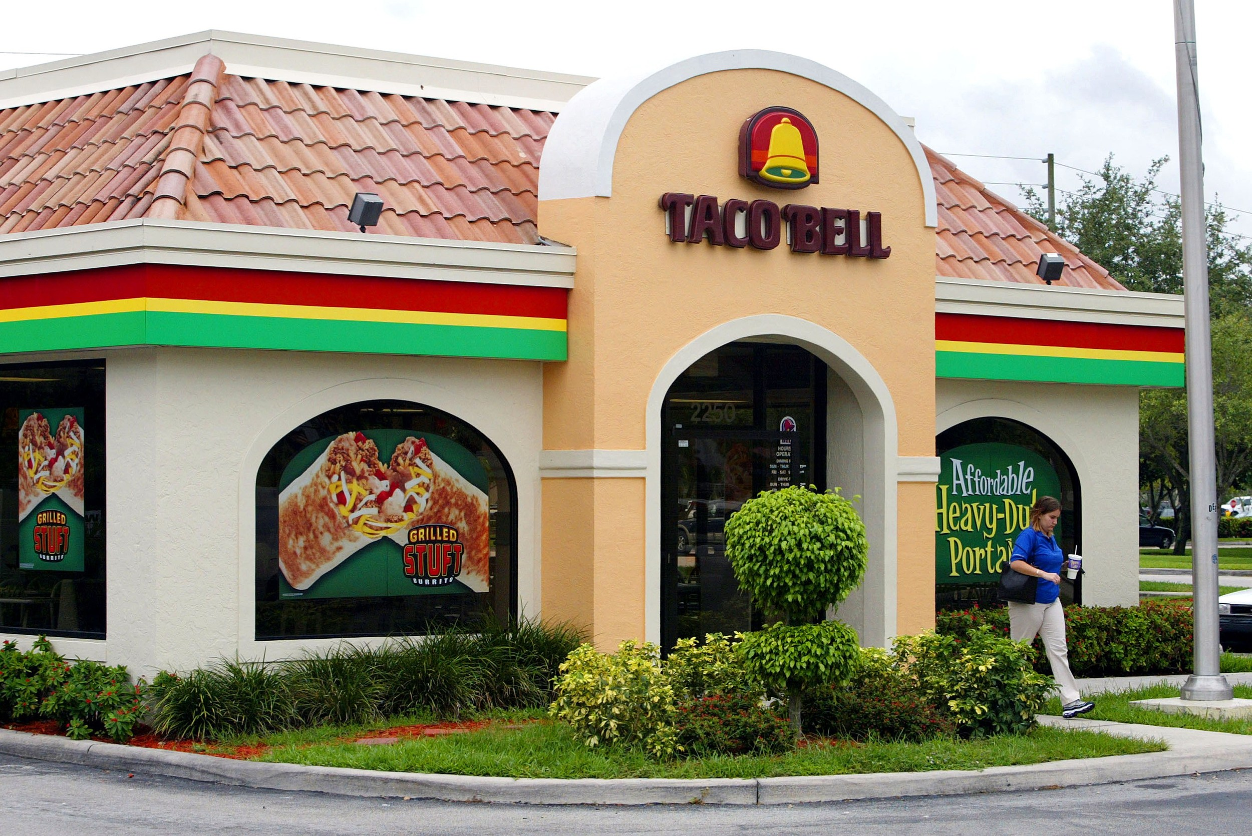 "A woman leaves a Taco Bell restaurant June 14, 2002 where ""dirty"" bomb suspect Jose Padilla worked for two years in Davie, Florida."